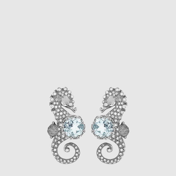 Sea-horses in white Gold