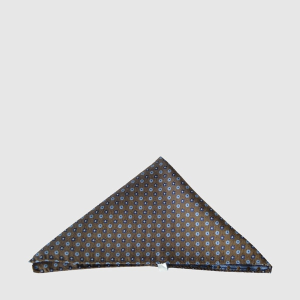 Silk pocket square on a brown background