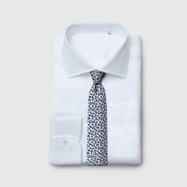 Cravatta 5 pieghe con fondo panna e fiori blu