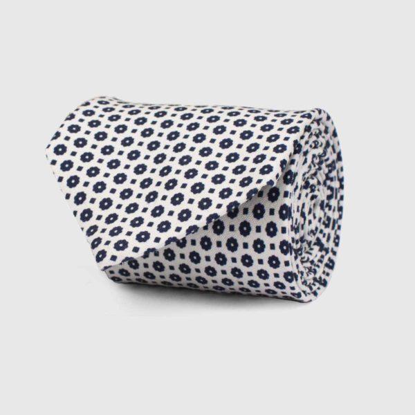 Cravatta 5 pieghe con fondo panna micromotivo blu