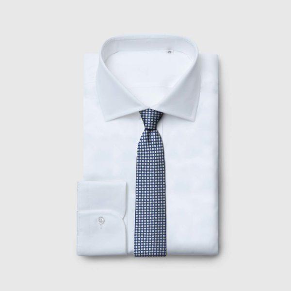 Cravatta 5 piegheblu con fiori verdi e bianchi