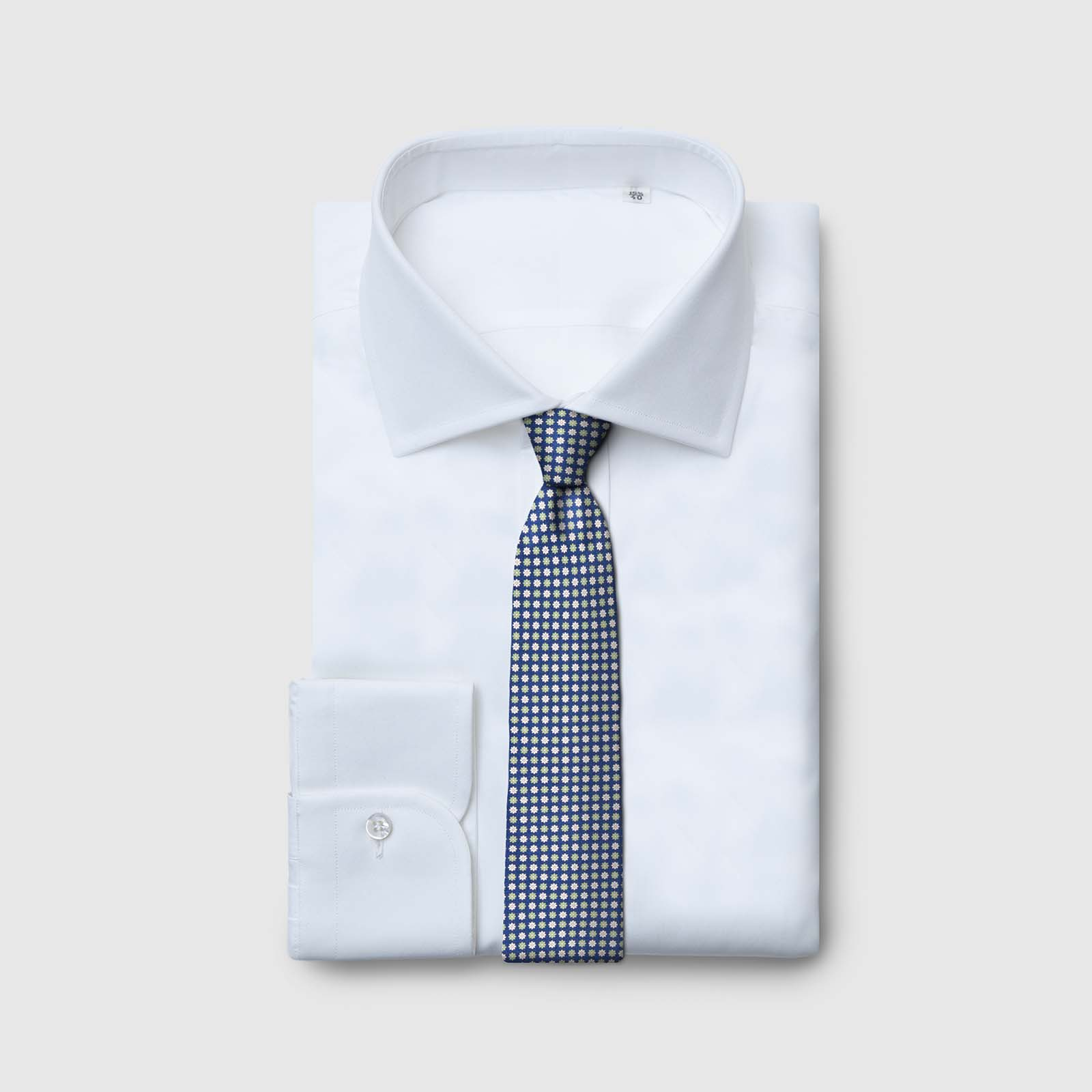 5 Fold blue Tie with green and white flowers