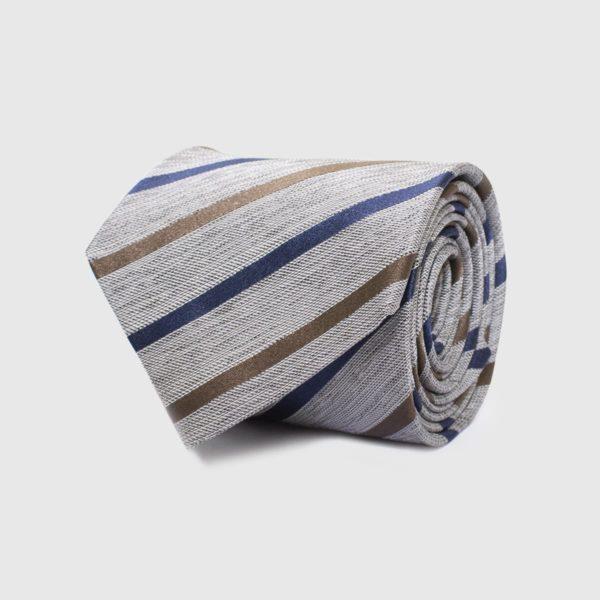 Cravatta 5 pieghe tessuta a righe su fondo beige