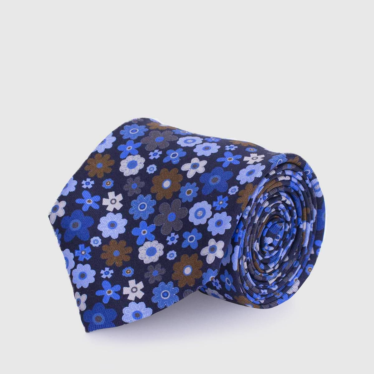 100% 5 Fold Silk Tie in a blue background and flowers