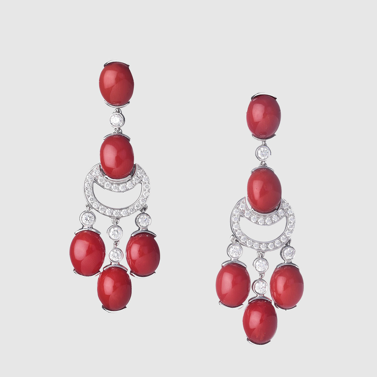 Oval Cabochon corals White gold earrings
