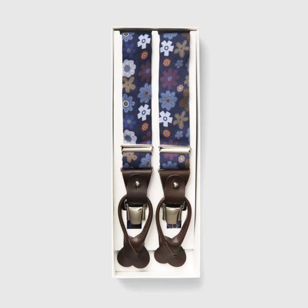 Bretelle in pelle marrone e seta stampata con fiori iconici
