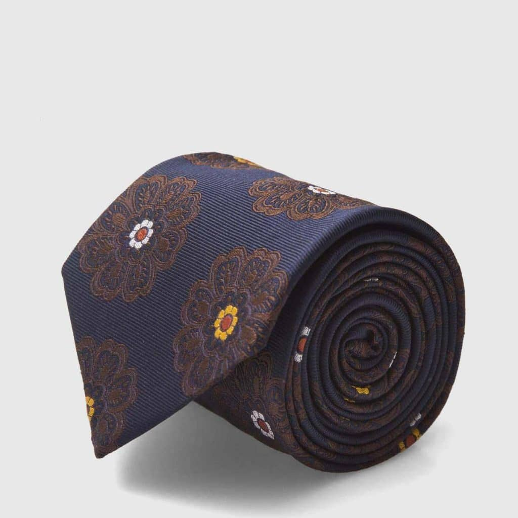 5 Fold white tie with blue navy background and flowers