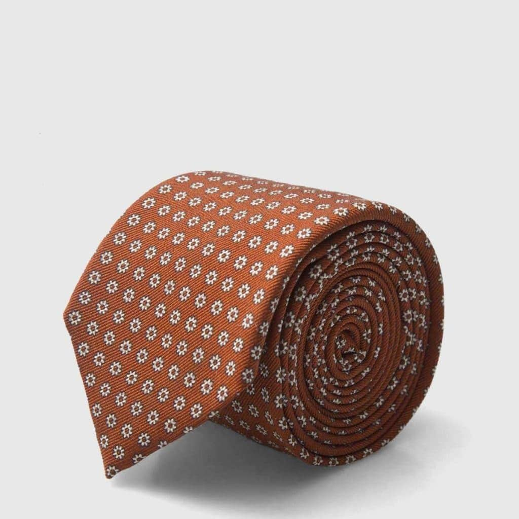 Orange Tie with an iconic floral motif