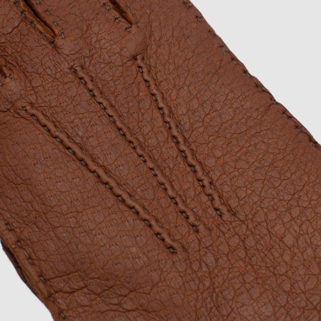 Guanto in vero Pecary nappato cucito interamente a mano foderato puro cashmere