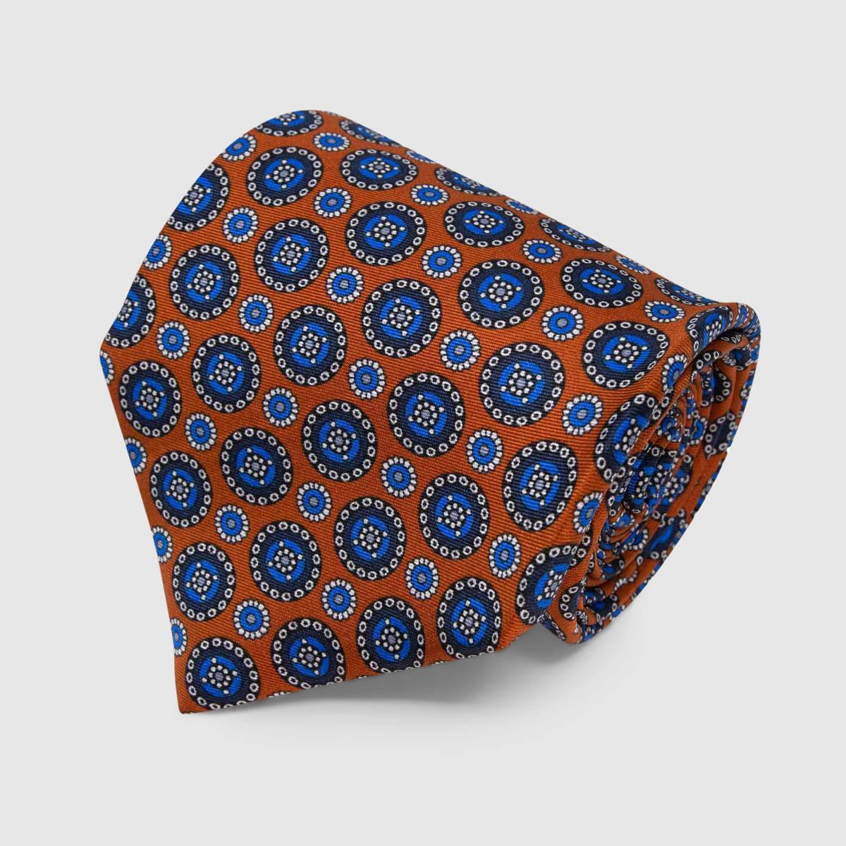 Cravatta di Seta arancione con motivo rotondo blu